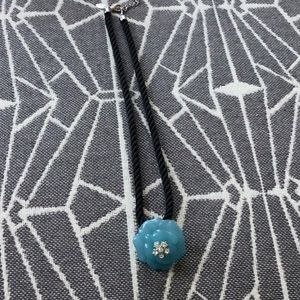 Nolan Miller cord necklace with pretty flower